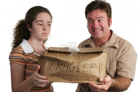Photo for A delivery man bringing a smashed package to a customer who looks confused and unhappy - Royalty Free Image