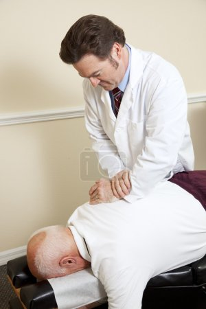 Senior Man with Chiropractor