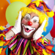 Birthday clown in full costume, looking surprised....