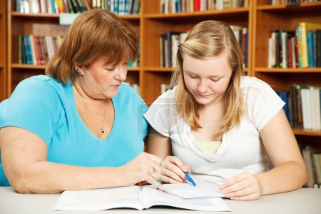 Mother Helps Teen with Homework