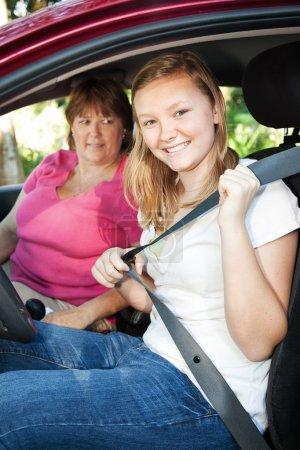 Teenage Driver Fastens Seatbelt