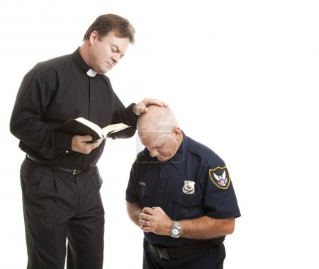 Priest Blesses Policeman