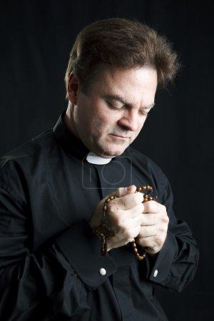 Priest in Prayer
