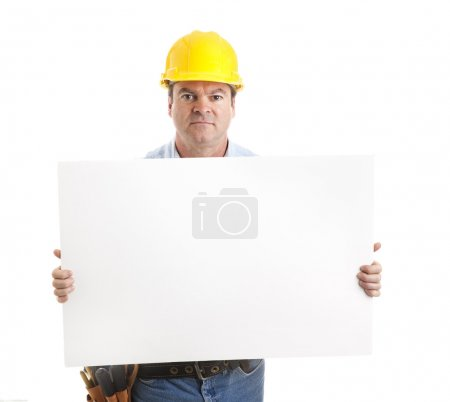 Serious Worker Carries Sign
