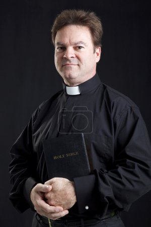 Solemn Priest With Bible
