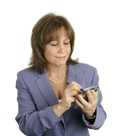 Photo for A businesswoman checking her schedule on her PDA. - Royalty Free Image