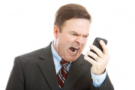 Photo for Angry businessman yelling into a cellphone. Isolated on white. - Royalty Free Image