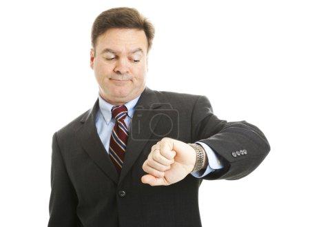 Photo pour Homme d'affaires impatient vérifie sa montre. isolé sur blanc. - image libre de droit