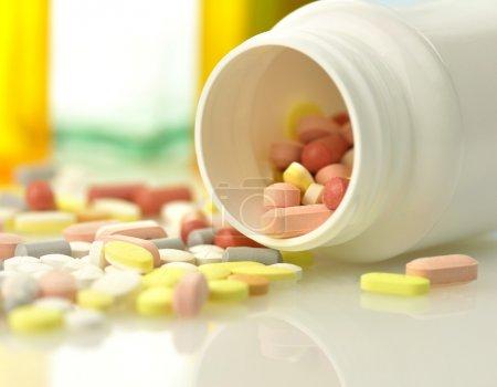 Medicine bottles and pills close up