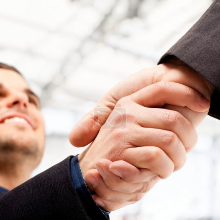 Photo for Business shaking hands. Bright blurred background. - Royalty Free Image