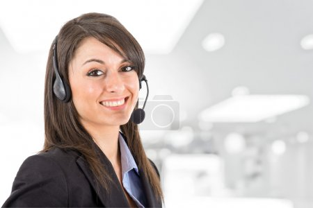 Photo for Portrait of a beautiful girl with headset - Royalty Free Image