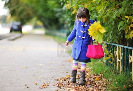 Funky little child girl in autumn atmosphere