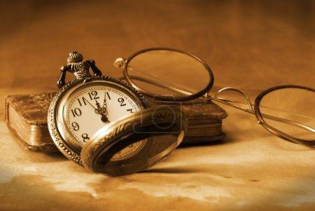 Photo for An antique pocket watch, glasses and bible come together in this vintage still life. - Royalty Free Image