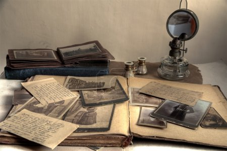 Old photos in sepia, postcards, letters, books, op...