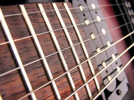 Close up electric guitar frets