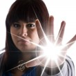A woman with special powers shooting a burst of li...