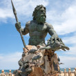 A large public statue of King Neptune welcomes all...