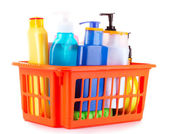 Bottles of beauty and bath products in orange box isolated on wh