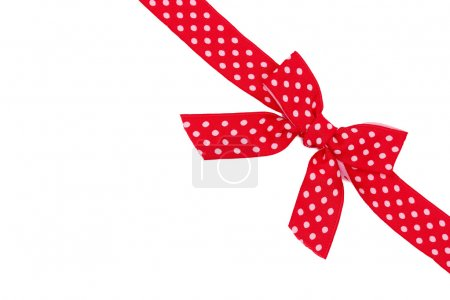 Dotted red ribbon and bow isolated on white background