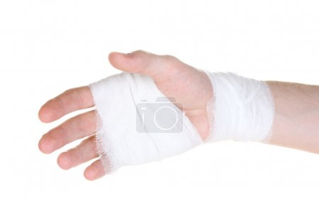 Bandaged hand isolated on white