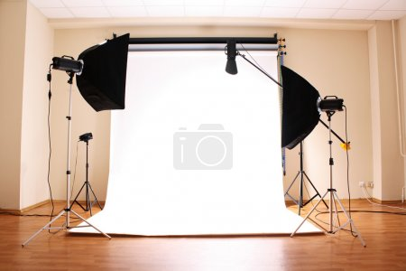 Photo for Empty photo studio with lighting equipment - Royalty Free Image