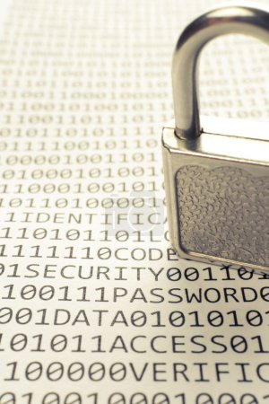 Photo for Padlock is on the list with a binary code and few words about safety - Royalty Free Image