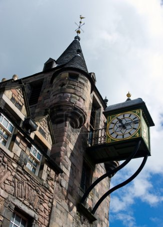 Photo for Old city clock on stone tower. Scotland. Edinburgh. - Royalty Free Image