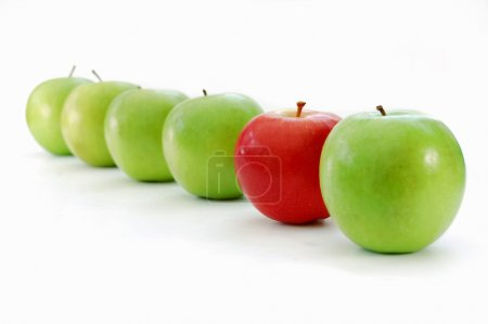 Red apple stands out in a line of green apples...