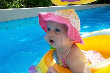 A cute baby girl in swimming pool