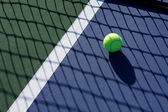 Tennis Ball in the Shadow