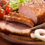 Close-up of a roast tenderloin pork served with ve...