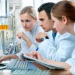 Group of scientists working at the laboratory...
