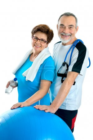 Photo for Smiling elderly couple working out in gym. Isolated on white - Royalty Free Image