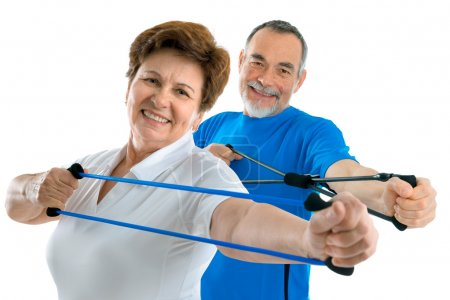 Photo for Senior couple doing exercises with a resistance band - Royalty Free Image