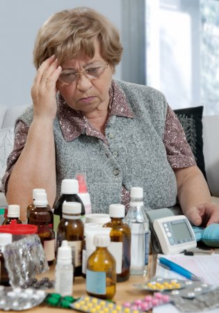 Photo for Senior woman with her medicine bottles - Royalty Free Image