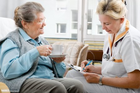 Healthcare worker and senior woman