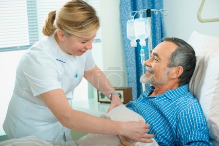 Photo for Nurse cares for a senior patient in hospital - Royalty Free Image