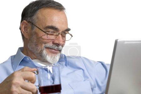 Senior on laptop.