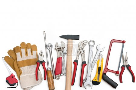Photo for Assorted building tools over a white background - Royalty Free Image