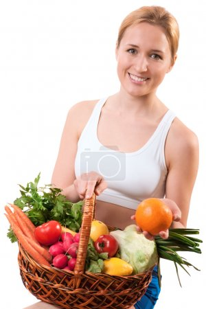 Photo for Young woman holding basket of vegetables - Royalty Free Image