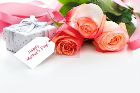 Photo for Bouquet of roses and gift box with a mothers day card - Royalty Free Image