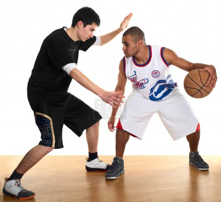 Two sportsmen playing basketball