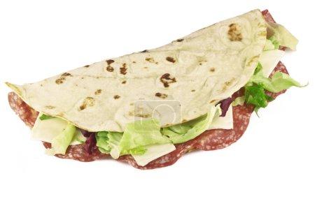 Photo pour Piadina romagnola, sandwich italien traditionnel - image libre de droit