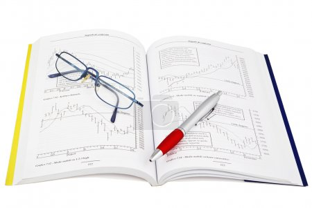Photo for Studying economy with trader book - Royalty Free Image