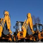 New, shiny and modern orange excavator machines. C...