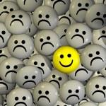 One positive yellow smilie between negative grey s...