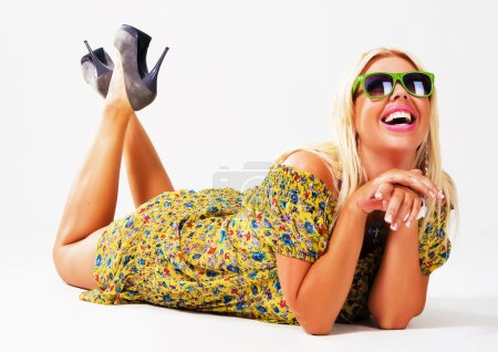 Photo for Portrait of a beautiful cheerful blonde in green sunglasses - Royalty Free Image