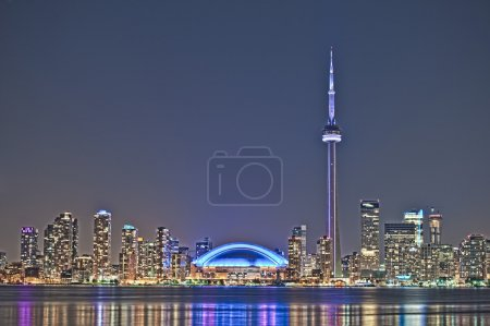 Photo for The landmark Toronto downtown view from the center island. Scenic view of the CN Tower illuminated by the iconic downtown skyline of skyscrapers and high rise c - Royalty Free Image