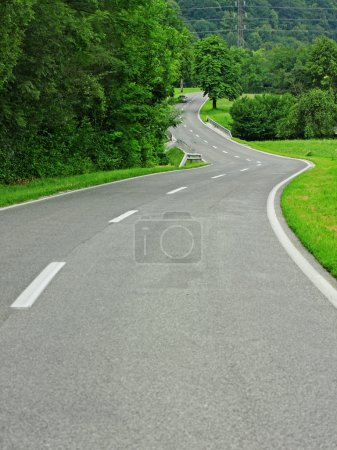 Asphalt winding curve road