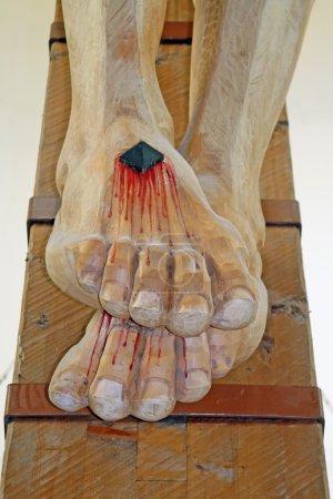 Nailed and bleeding feet of Jesus